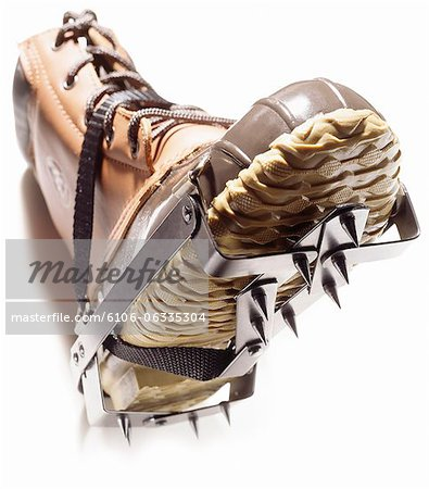 A pair of winter boots fitted with crampons Stock Photo - Premium Royalty-Free, Image code: 6106-06335304