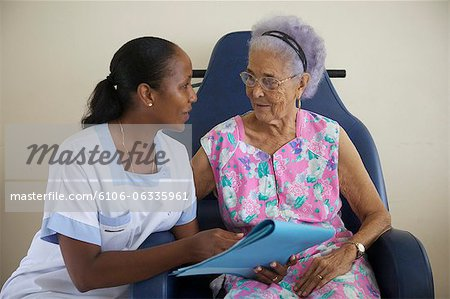 Nurse Assisting Senior Stock Photo - Premium Royalty-Free, Image code: 6106-06335961