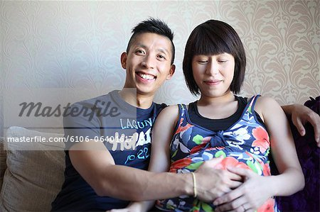 Happy Asian expectant couple Stock Photo - Premium Royalty-Free, Image code: 6106-06401617