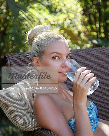 Young lady drinking water closeup Stock Photo - Premium Royalty-Free, Image code: 6106-06434755
