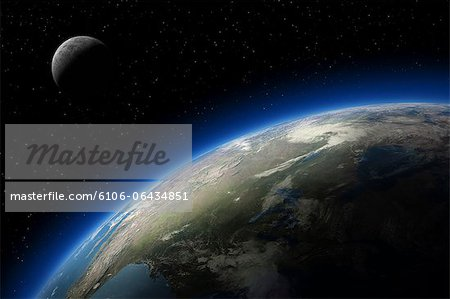 Earth and moon as seen from space Stock Photo - Premium Royalty-Free, Image code: 6106-06434851