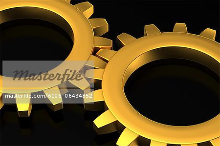 Two Golden Cog Wheels Stock Photo - Premium Royalty-Free, Image code: 6106-06434852