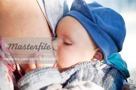 baby breastfeeding Stock Photo - Premium Royalty-Free, Image code: 6106-06536465