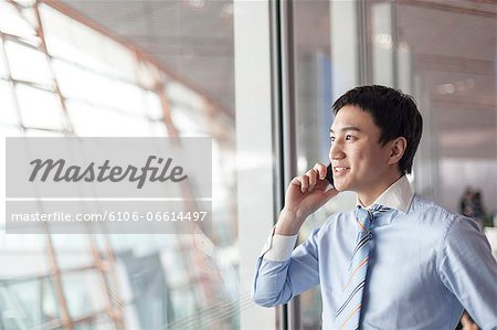 businessman in airport Stock Photo - Premium Royalty-Free, Image code: 6106-06614497