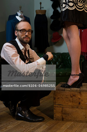 Tailor standing by female model, smiling Stock Photo - Premium Royalty-Free, Image code: 6106-06985255