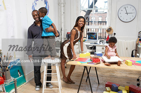 Family at home, son (6-7) kissing father Stock Photo - Premium Royalty-Free, Image code: 6106-06988668
