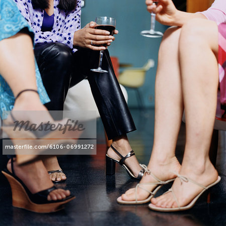 Low Section of Three Women with Wine Stock Photo - Premium Royalty-Free, Image code: 6106-06991272