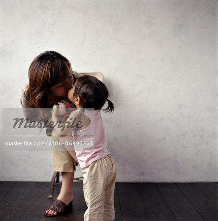 Mother giving toddler girl (2-4) kiss Stock Photo - Premium Royalty-Free, Image code: 6106-06993253