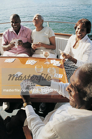 Senior Couples Playing Cards on the Deck of a Boat Stock Photo - Premium Royalty-Free, Image code: 6106-06999591