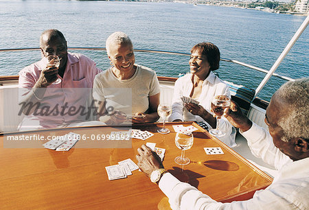 Senior Couples Playing Cards on the Deck of a Boat Stock Photo - Premium Royalty-Free, Image code: 6106-06999592