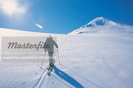 Rear View of a Person Cross Country Skiing Stock Photo - Premium Royalty-Free, Image code: 6106-07003453