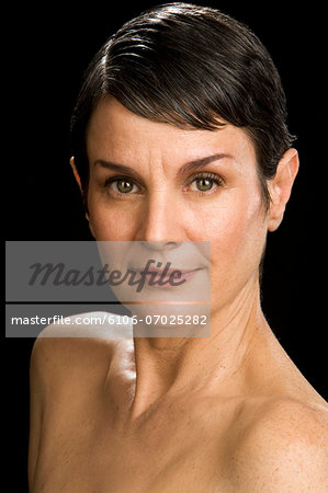 Shirtless mature woman, portrait, close-up Stock Photo - Premium Royalty-Free, Image code: 6106-07025282