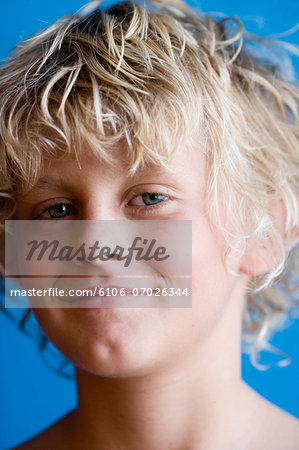 Portrait of blonde boy (12-13), studio shot Stock Photo - Premium Royalty-Free, Image code: 6106-07026344
