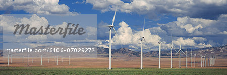 Field of wind generators, mountains and sky beyond Stock Photo - Premium Royalty-Free, Image code: 6106-07029272