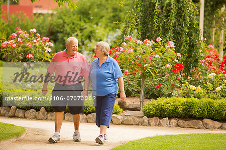 Senior Couple Walking in a Park Stock Photo - Premium Royalty-Free, Image code: 6106-07070002