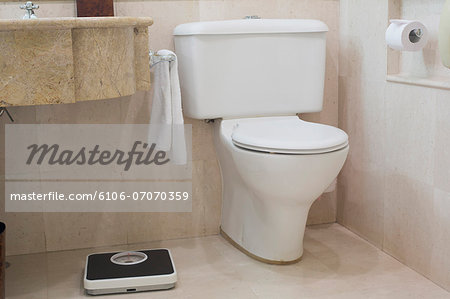 Toilet and Scales Stock Photo - Premium Royalty-Free, Image code: 6106-07070359