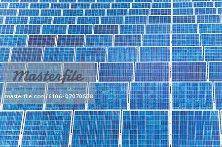 High angle view of blue solar panels Stock Photo - Premium Royalty-Free, Image code: 6106-07070538