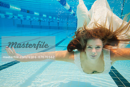 Underwater Bride Stock Photo - Premium Royalty-Free, Image code: 6106-07070562
