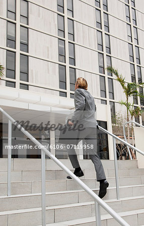 businessman climbing stairs Stock Photo - Premium Royalty-Free, Image code: 6106-07119958