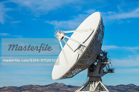 Satellite dish in desert with blue sky Stock Photo - Premium Royalty-Free, Image code: 6106-07120323