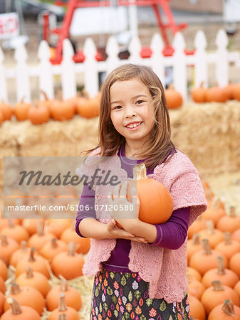 Kids at pumpkin patch Stock Photo - Premium Royalty-Free, Image code: 6106-07120580