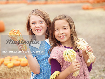 Kids at pumpkin patch Stock Photo - Premium Royalty-Free, Image code: 6106-07120595