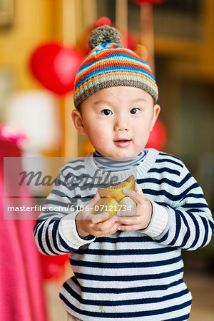 Celebrating Chinese new year Stock Photo - Premium Royalty-Free, Image code: 6106-07121734