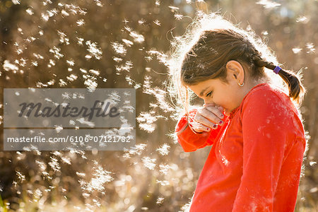 Girl suffering from allergies outdoors Stock Photo - Premium Royalty-Free, Image code: 6106-07121782