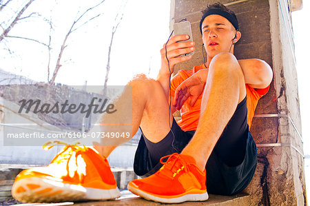 A young male working out and stretching outside. Stock Photo - Premium Royalty-Free, Image code: 6106-07349049