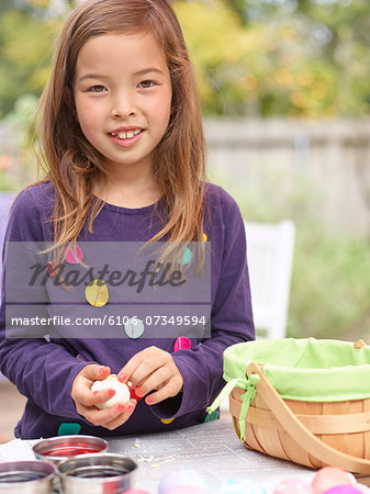 Easter egg coloring and egghunt Stock Photo - Premium Royalty-Free, Image code: 6106-07349594