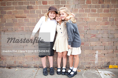 Friends at school in uniform Stock Photo - Premium Royalty-Free, Image code: 6106-07349690