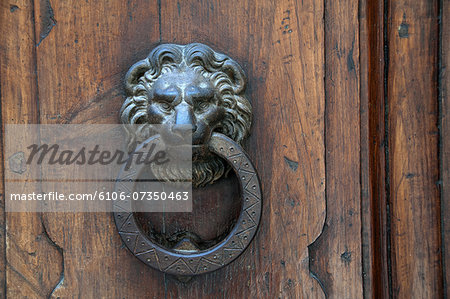 Walled city of San Gimignano door knocker Stock Photo - Premium Royalty-Free, Image code: 6106-07350463