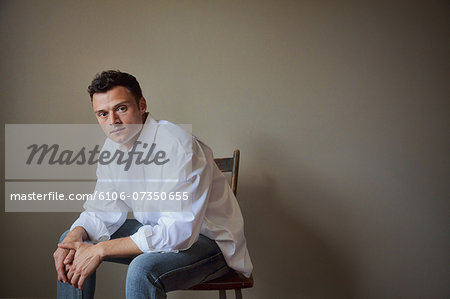 Portrait of a young man Stock Photo - Premium Royalty-Free, Image code: 6106-07350655
