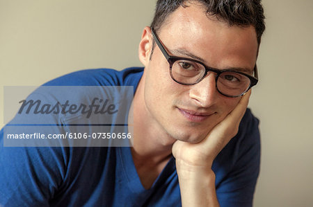 Portrait of a young man Stock Photo - Premium Royalty-Free, Image code: 6106-07350656