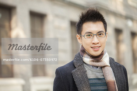young student in campus Stock Photo - Premium Royalty-Free, Image code: 6106-07350972