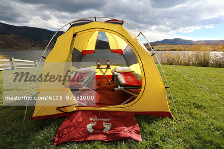 Tent set up at lakeside campsite in fall season Stock Photo - Premium Royalty-Free, Image code: 6106-07351000