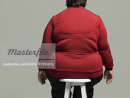 Obese woman on chair Stock Photo - Premium Royalty-Free, Image code: 6106-07351011
