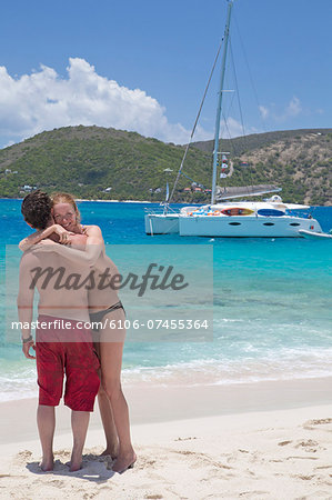 Couple hugging on the beach Stock Photo - Premium Royalty-Free, Image code: 6106-07455364