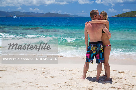Couple standing on beach Stock Photo - Premium Royalty-Free, Image code: 6106-07455454
