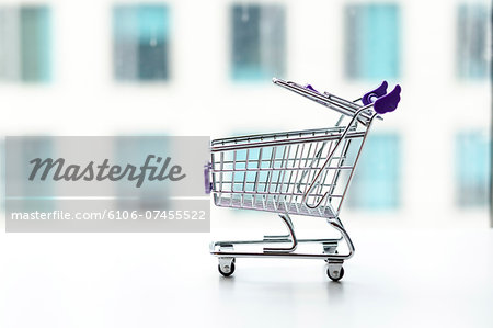 shopping cart in office building background Stock Photo - Premium Royalty-Free, Image code: 6106-07455522