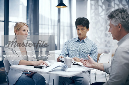Casual meeting in the cafeteria Stock Photo - Premium Royalty-Free, Image code: 6106-07493414