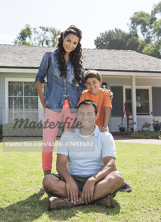 Latino Family in Front of House Stock Photo - Premium Royalty-Free, Image code: 6106-07493602