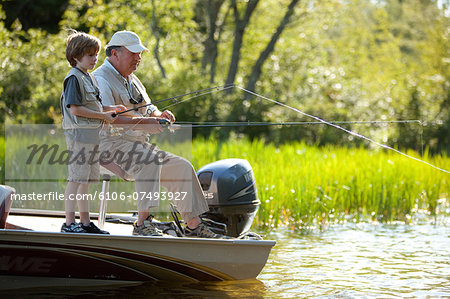 Grandfather & Grandson fishing Stock Photo - Premium Royalty-Free, Image code: 6106-07493927