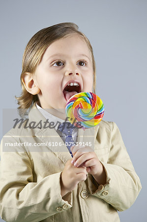 Boy (3-5) licking lolly Stock Photo - Premium Royalty-Free, Image code: 6106-07539145
