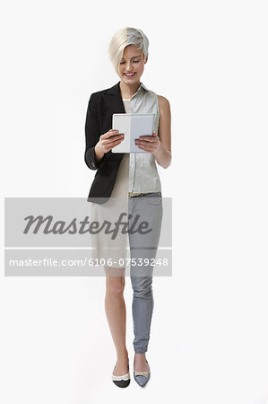 woman using computer tablet at home and at work Stock Photo - Premium Royalty-Free, Image code: 6106-07539248