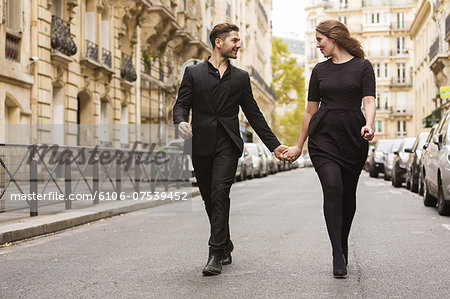Well Dressed Loving Couple Stock Photo - Premium Royalty-Free, Image code: 6106-07539452