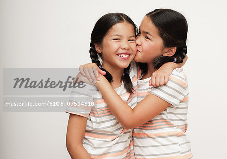 Young sisters in braids, laughing Stock Photo - Premium Royalty-Free, Image code: 6106-07594818