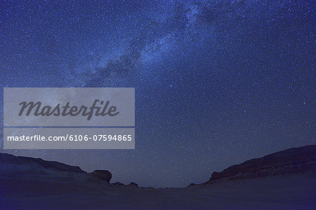 Starry Sky and Milky Way Stock Photo - Premium Royalty-Free, Image code: 6106-07594865