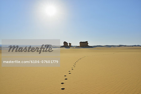 Footprints in Desert Stock Photo - Premium Royalty-Free, Image code: 6106-07601779