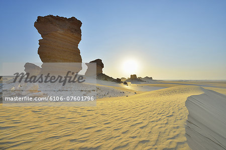 Rock Formation in Desert at Sunrise Stock Photo - Premium Royalty-Free, Image code: 6106-07601796